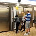 Customers checking out the beauty and movement of a built-in fridge from Viking.