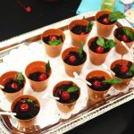 Some of the most delicious recipes are the easiest to make. Here we have mud pie parfaits with maraschino cherry and basil leaves.